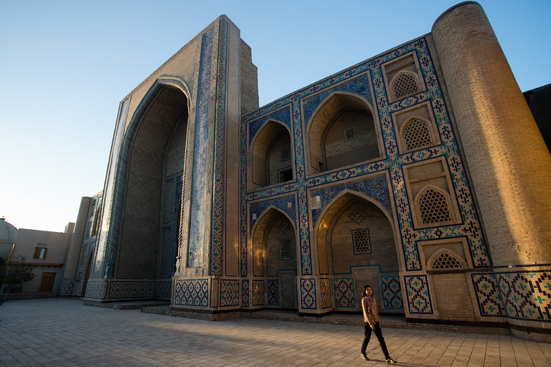 Bukhara's Ulugbek Medrasa as the sun sets over the city.