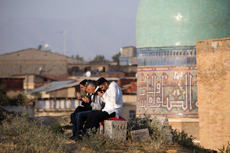 Local men gather for prayer on Kurban Eid in the cemetery behind the Shah-i-Zinda Mausoleum complex in Samarkand, Uzbekistan.