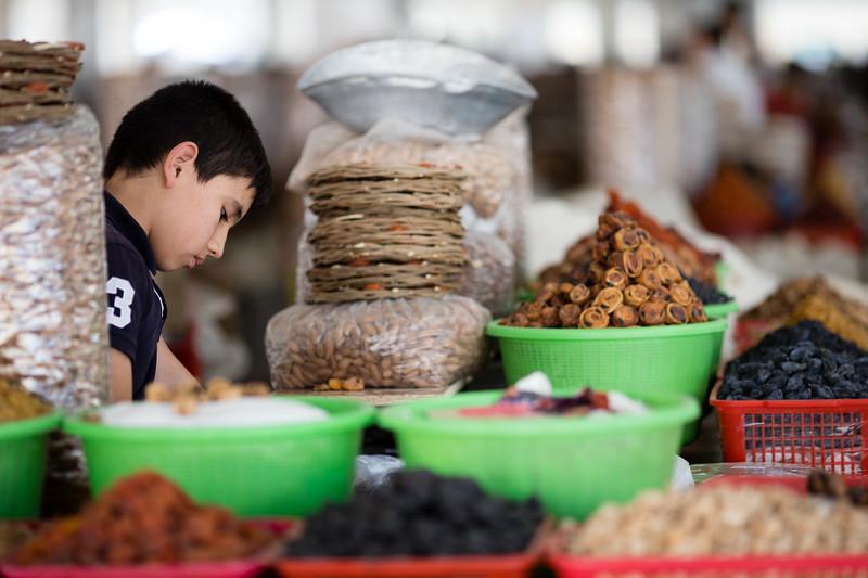 A young vendor at the Siob Bazaar in Samarkand, Uzbekistan.