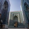 A local pilgrim at the Shah-i-Zinda Mausoleum complex in Samarkand, Uzbekistan.