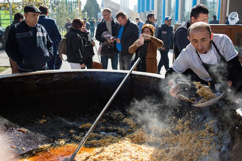 Plov is served from large kazans outside the Plov Centre of Central Asia in Tashkent, Uzbekistan.