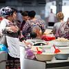 Female vendors chat at the Chorsu Bazaar in Tashkent, Uzbekistan.