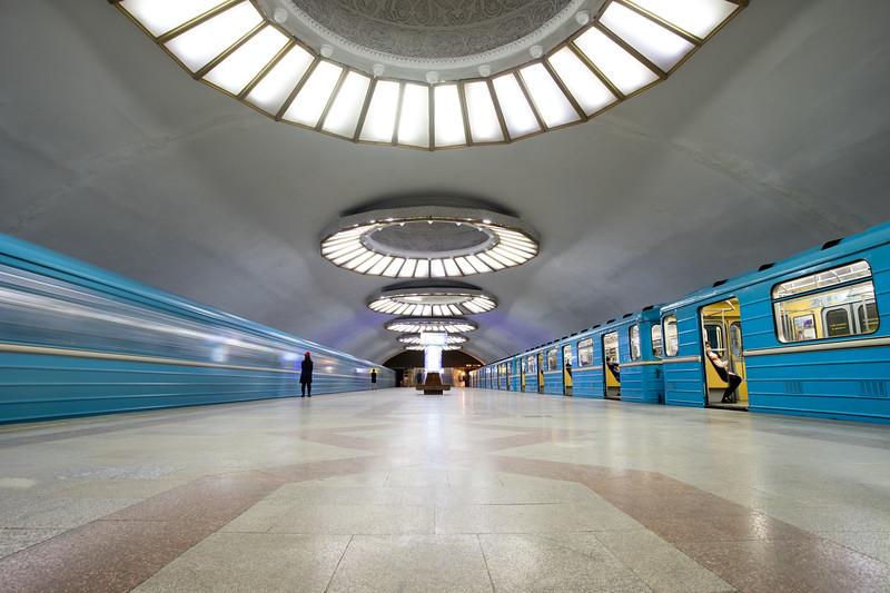 Passengers board trains in the Soviet-era Buyuk Ipek Yolu metro station in Tashkent, Uzbekistan.