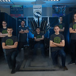 NSA CyberPatriot Team Photo with a throne made of computers.