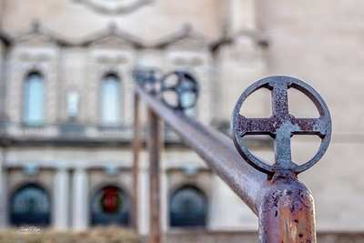 Cross adorned hand-rail leading to St. Cecelia's Cathedral in Omaha, Nebraska. Enjoy and hold hands.
