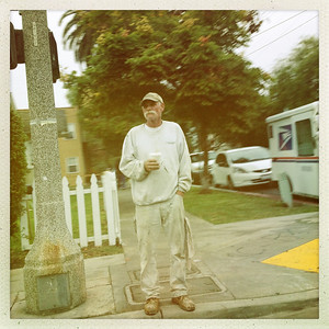 11.29.12. Man waiting on the corner. Rainy day.