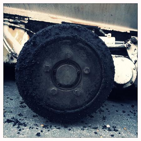 Asphalt covered wheel.