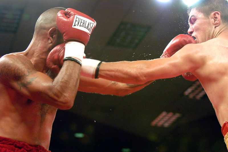 (7-30-2005)  Tucsonan Nito Bravo (left) and Ernesto Zepeda exchange blows in the  4th round of their 12 round IBA Continental Americas Junior Welterweight Championship bout at the Desert Diamond Casino.  Zepeda went on to win a 12 round split decision.