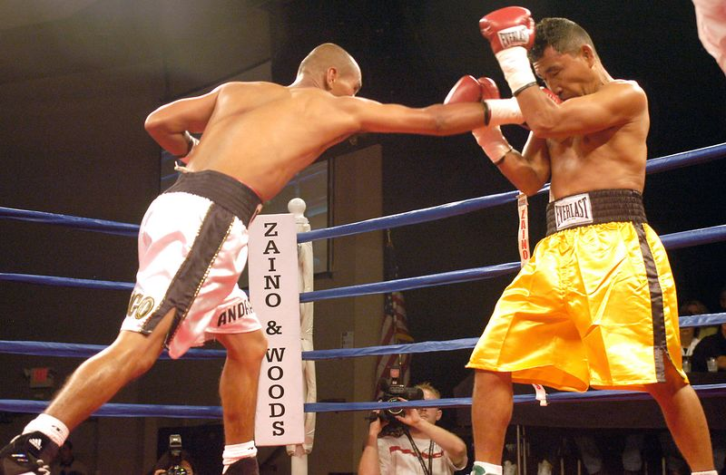 (7-30-2005)  Oscar Andrade (left) lands a blow to the face of Paulino Villalobos in the 1st round of their 12 round WBO Latino Bantamweight Fight at the Desert Diamond Casino.  Andrade won a unanimous 12 round decision.