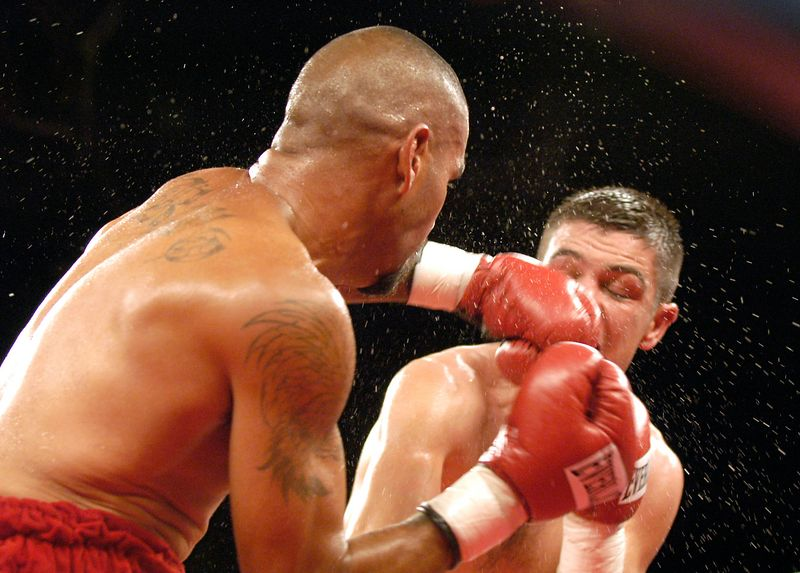 (7-30-2005)  Tucsonan Nito Bravo (left) delivers a punch to the face of Ernesto Zepeda in the 3rd round of their 12 round IBA Continental Americas Junior Welterweight Championship bout at the Desert Diamond Casino.  Zepeda went to win a 12 round split decision.