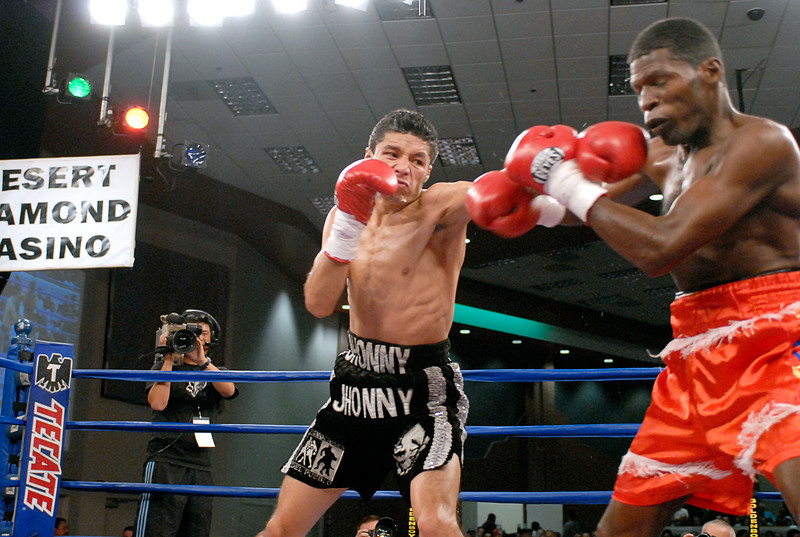 (3.30.2007 - Desert Diamond Casino)  Jhonny Gonzalez connects with a right hand to the jaw of Irene Pacheco during the 4th round of their WBO Championship bout.  Gonzalez successfully defended his belt with a 9th round TKO.