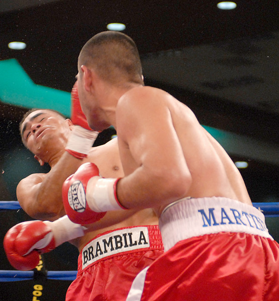 (3.30.2007 - Desert Diamond Casino)  Gabriel Martinez lands a right hand on Arturo Brambila in the 6th round of their welterweight bout.  Martinez scored a split decision.