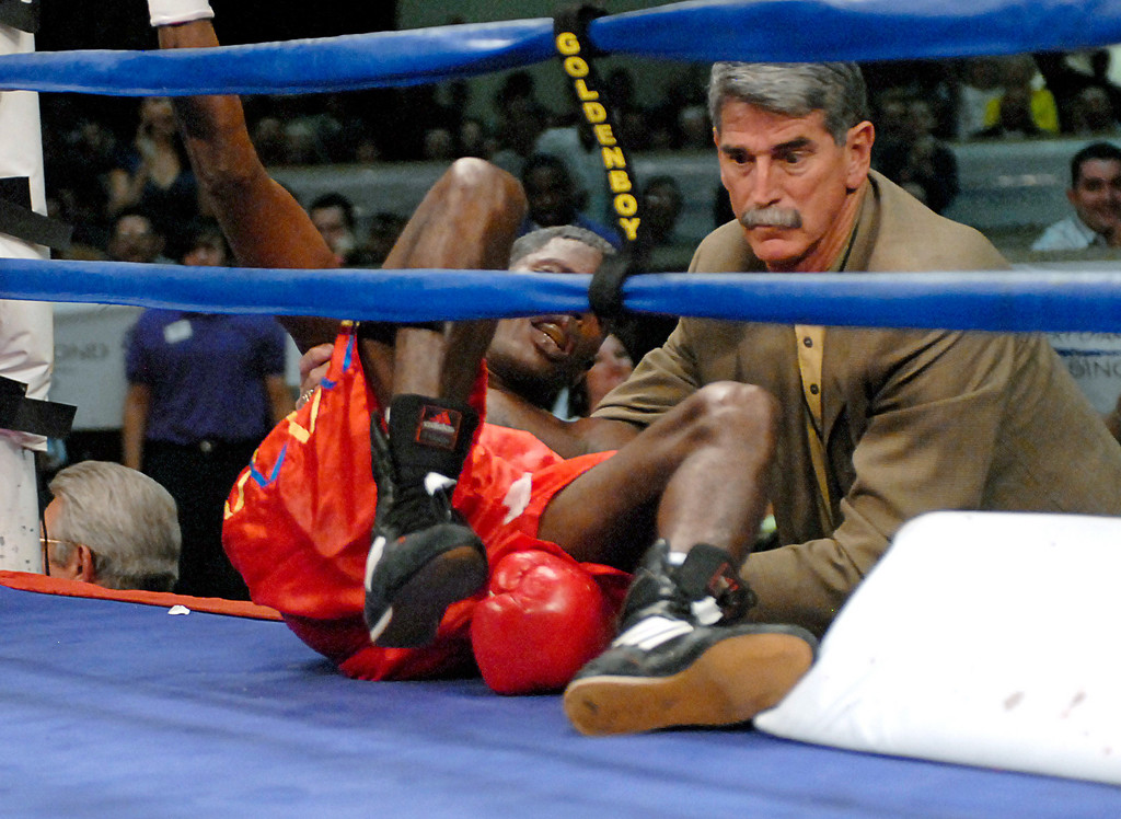 (3.30.2007 - Desert Diamond Casino)  Irene Pacheco lies on the ring apron after being knocked through the ropes by Jhonny Gonzalez in the 9th round of their WBO Bantamweight Championship bout.  Moments later the fight was stopped and Gonzalez retained his title.