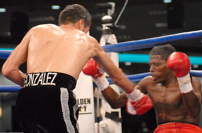 (3.30.2007 - Desert Diamond Casino)  Jhonny Gonzalez knocks Irene Pacheco out of the ring in the 9th round of their WBO Bantamweight Championship bout.  Moments later the referee stopped the fight.