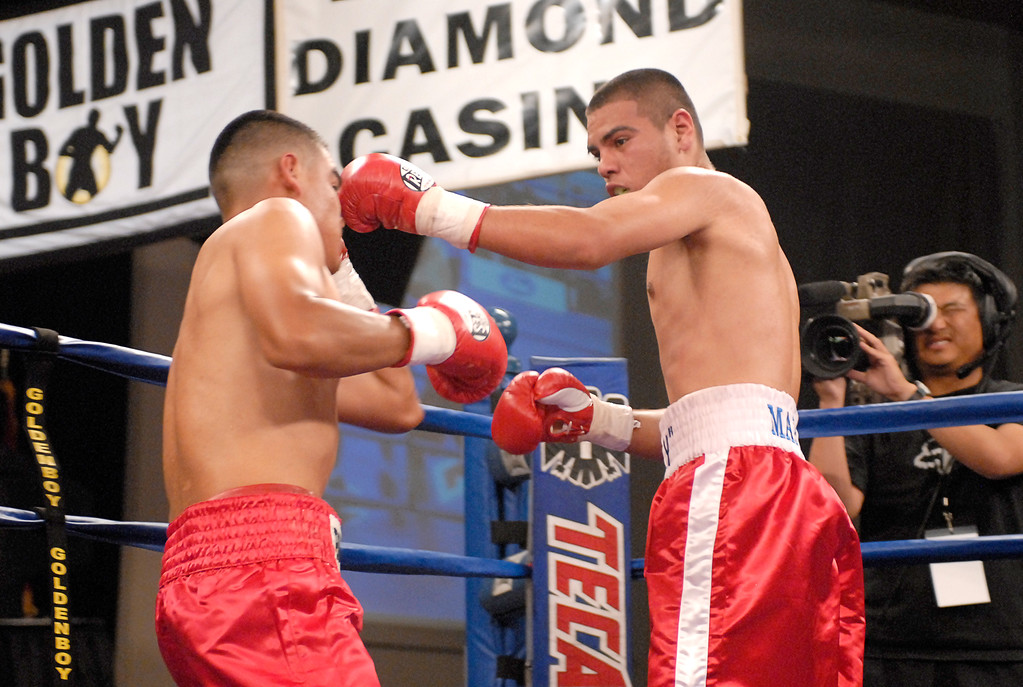 (3.30.2007 - Desert Diamond Casino)  Gabriel Martinez connects to the head of Arturo Brambila in the 2nd round of their Welterweight bout.  Martinez went on to win a split decision and remained undefeated.