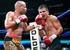 (3.10.2006 --- Desert Diamond Casino)  Emanuel Augustus scores on Arturo Morua in the 7th round of their WBO Intercontinental Championship bout.
