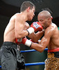 (3.10.2006 --- Desert Diamond Casino) Arturo Morua (left) and Emanuel Augustus exchange blows in the 11th round of their WBO Intercontinental Championship bout.