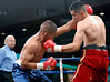 (3.10.2006 --- Desert Diamond Casino)  Juan Garcia scores with an uppercut against Raul Montes in the second round of their 4 round bout.