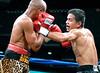 (3.10.2006 --- Desert Diamond Casino)  Arturo Morua scores on Emanuel Augustus in the 9th round of their 12 round WBO Intercontinental Championship bout.