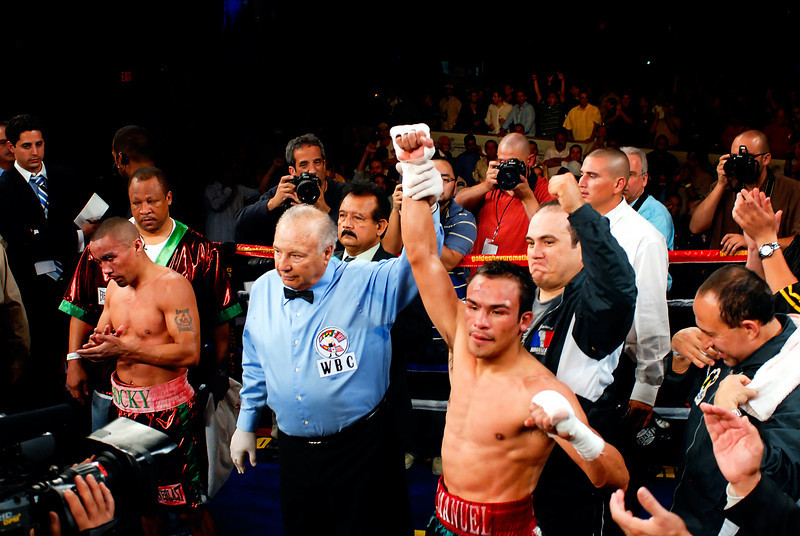 (11.3.2007 -- Tucson, Arizona)  Juan Manuel Marquez is declared the winner by unanimous decision over Rocky Juarez in their World Boxing Council Super Featherweight title bout.<br /> <br /> <br /> Images from the November 3, 2007 Golden Boy Productions fight card at the Desert Diamond Casino.