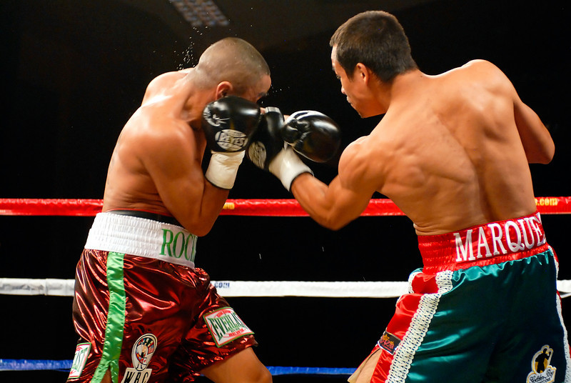 (11.3.2007 -- Tucson, Arizona)  Juan Manuel Marquez lands a left to the head of Rocky Juarez in the 1st round of their World Boxing Council Super Featherweight title bout.  Marquez went on to win a 12 round unanimous decision and successfully defend his title.<br /> <br /> <br /> Images from the November 3, 2007 Golden Boy Productions fight card at the Desert Diamond Casino.