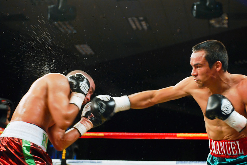 (11.3.2007 -- Tucson, Arizona)  Juan Manuel Marquez lands a right to the head of Rocky Juarez early in their World Boxing Council Super Featherweight title bout.  Marquez went on to win a 12 round unanimous decision and successfully defend his title.<br /> <br /> <br /> Images from the November 3, 2007 Golden Boy Productions fight card at the Desert Diamond Casino.