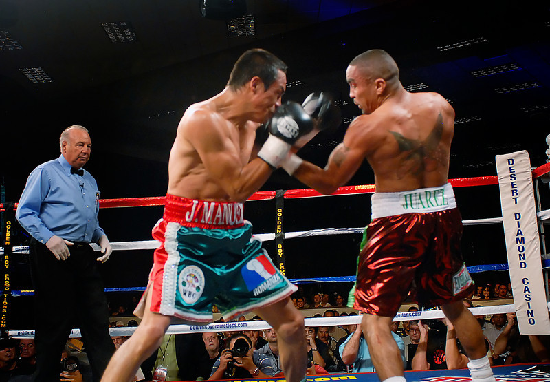 (11.3.2007 -- Tucson, Arizona)  Rocky Juarez scores on a left hand upper cut to the head of Juan Manuel Marquez in the 3rd round of their World Boxing Council Super Featherweight title bout.  Marquez went on to win a 12 round unanimous decision and successfully defend his title.<br /> <br /> <br /> Images from the November 3, 2007 Golden Boy Productions fight card at the Desert Diamond Casino.