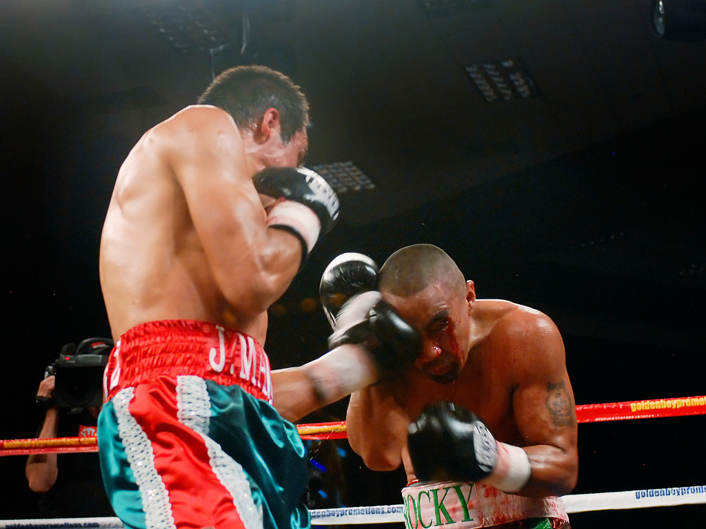 (11.3.2007 -- Tucson, Arizona)  Juan Manuel Marquez lands a left to the head of Rocky Juarez in the 6th round of their World Boxing Council Super Featherweight title bout.  Marquez went on to win a 12 round unanimous decision and successfully defend his title.<br /> <br /> <br /> Images from the November 3, 2007 Golden Boy Productions fight card at the Desert Diamond Casino.