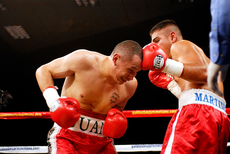 (11.3.2007 -- Tucson, Arizona)  Gabriel Martinez lands a blow on the top of Juan Pablo Montes de Oca's head in the 2nd round of their 6 round super welterweight fight at the Desert Diamond Casino.  Martinez won a split decision.<br /> <br /> Images from the November 3, 2007 Golden Boy Productions fight card at the Desert Diamond Casino.