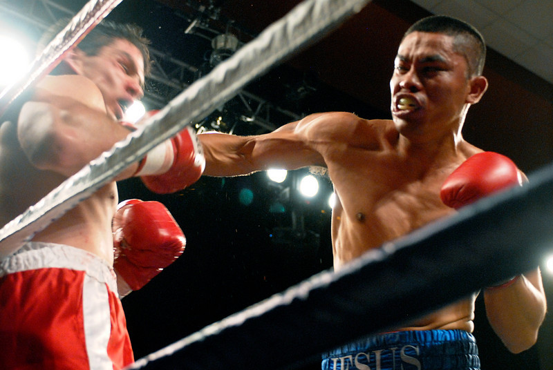 (11.3.2007 -- Tucson, Arizona)  Jesus Selig (right) pins Daniel Gonzalez against the rope in their 4 round bout at the Desert Diamond Casino.  Selig remained undefeated at 5-0-1 with a split decision.<br /> <br /> Images from the November 3, 2007 Golden Boy Promotions fight card at the Desert Diamond Casino.