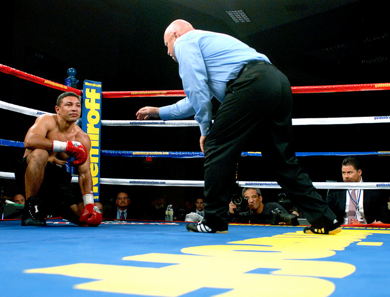"(11.3.2007 -- Tucson, Arizona)   Referee Wes Melton gives Abdias Castillo eight count after Castillo was knocked down by Joshua ""Kid Bacon"" Renteria in the 3rd round of their 4 round Super-Welterweight bout at the Desert Diamond Casino.  Melton did not let the fight continue.<br /> <br /> Images from the November 3, 2007 Golden Boy Productions fight card at the Desert Diamond Casino."