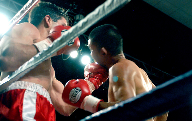 (11.3.2007 -- Tucson, Arizona)  Daniel Gonzales and Jesus Selig exchange blow in close quarter fighting during their 4 round bout at the Desert Diamond Casino.  Selig remained undefeated at 5-0-1 with a split decision.<br /> <br /> Images from the November 3, 2007 Golden Boy Productions fight card at the Desert Diamond Casino.