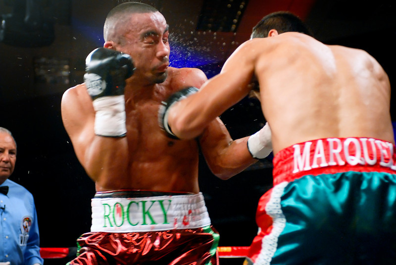 (11.3.2007 -- Tucson, Arizona)  Juan Manuel Marquez scores on Rocky Juarez in the 2nd round of their World Boxing Council Super Featherweight title bout.  Marquez went on to win a 12 round unanimous decision and successfully defend his title.<br /> <br /> <br /> Images from the November 3, 2007 Golden Boy Productions fight card at the Desert Diamond Casino.