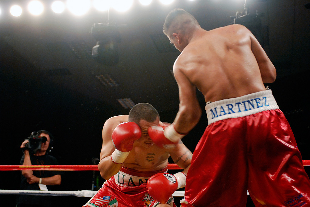 (11.3.2007 -- Tucson, Arizona)   Gabriel Martinez connects with an uppercut to the head of Juan Pablo Montes de Oca in the 6th and final round of their super welterweight fight at the Desert Diamond Casino.  Martinez ulitimately won a split decision.