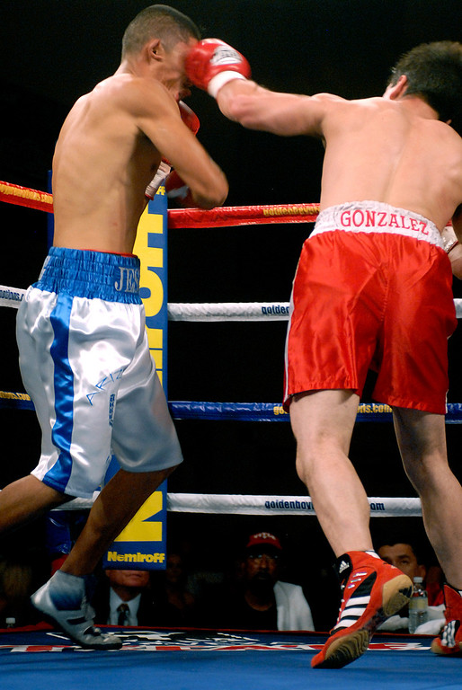 (11.3.2007 -- Tucson, Arizona)  Daniel Gonzales scores with a shot to the head of Jesus Selig in their 4 round bout at the Desert Diamond Casino.  Selig remained undefeated at 5-0-1 with a split decision.<br /> <br /> Images from the November 3, 2007 Golden Boy Productions fight card at the Desert Diamond Casino.