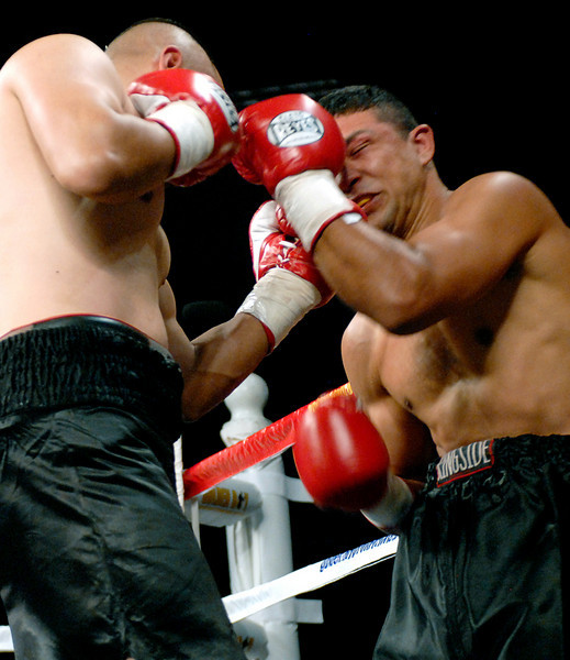 """(11.3.2007 -- Tucson, Arizona) Joshua """"Kid Bacon"""" Renteria lands a blow to the head of Abdias Castillon in their 4 round Super-Welterweight bout at the Desert Diamond Casino.  Renteria prevailed with a third round TKO.<br /> <br /> Images from the November 3, 2007 Golden Boy Productions fight card at the Desert Diamond Casino."""