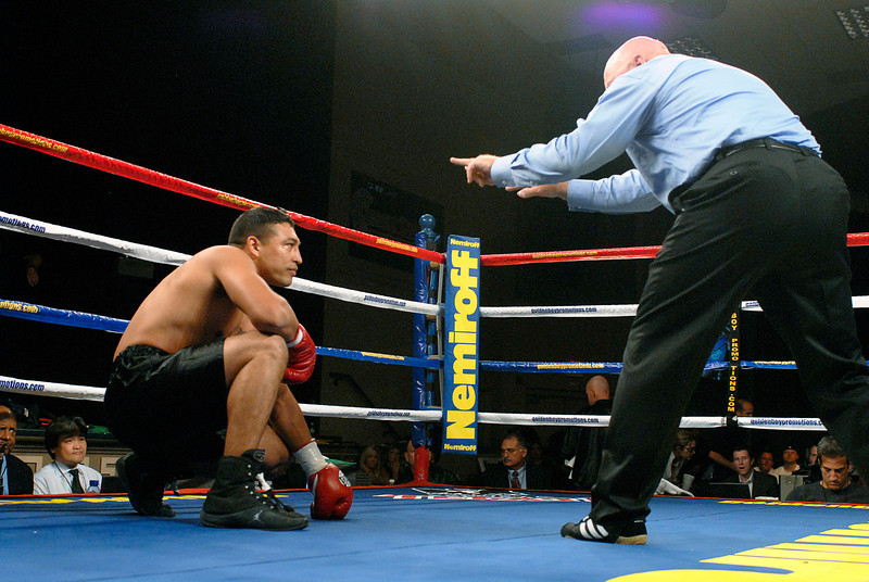 "(11.3.2007 -- Tucson, Arizona) Referee Wes Melton gives Abdias Castillo an eight count after Castillo was knocked down by Joshua ""Kid Bacon"" Renteria in the 1st round of their 4 round Super-Welterweight bout at the Desert Diamond Casino.  Castillo was able to continue by Melton ultimately stopped the fight in the third round giving Renteria the victory by TKO.<br /> <br /> Images from the November 3, 2007 Golden Boy Productions fight card at the Desert Diamond Casino."