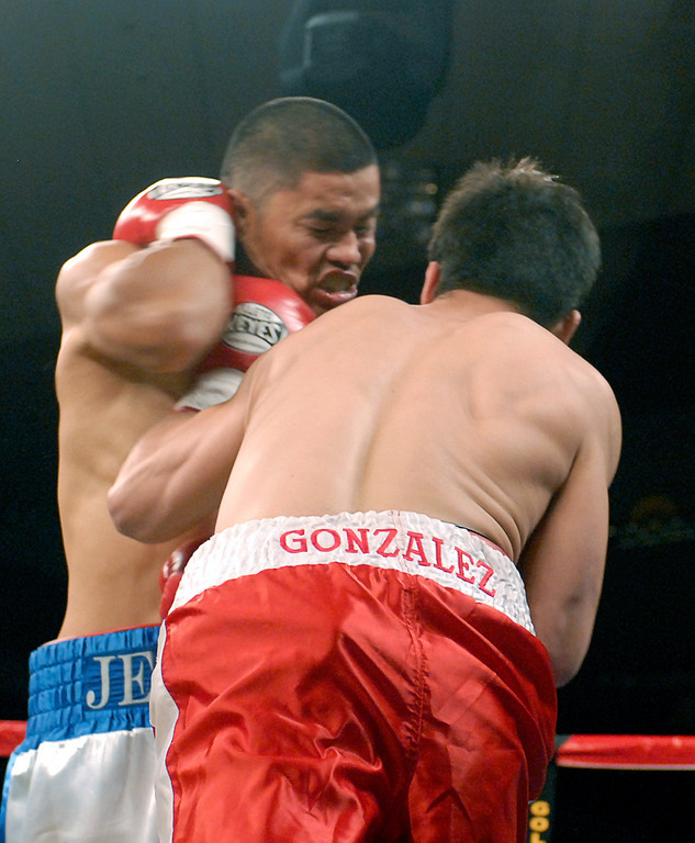 (11.3.2007 -- Tucson, Arizona)  Daniel Gonzales lands a blow to the head of Jesus Selig in their 4 round bout at the Desert Diamond Casino.  Selig remained undefeated at 5-0-1 with a split decision.<br /> <br /> Images from the November 3, 2007 Golden Boy Productions fight card at the Desert Diamond Casino.