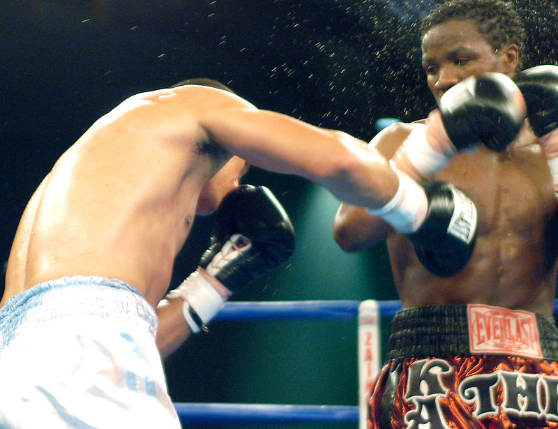 (1.27.2006 - Desert Diamond Casino, Tucson, AZ)  Sweat flies off Kassim Ouma after taking a shot to the midsection from Francisco Mora.