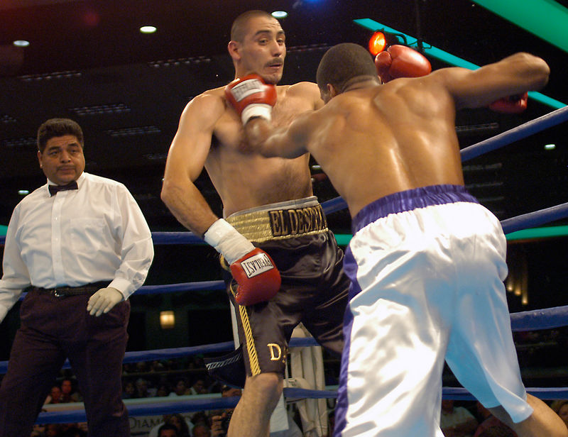 (1.27.2006 - Desert Diamond Casino, Tucson, AZ)  Shay Mobley catches David Lopez in the throat with a lefthand in their 10 round middleweight bout.