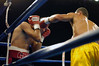 (1.27.2006 - Desert Diamond Casino, Tucson, AZ)  Perez slips a left in on Escobedo in the 6th round of their Jr. Lightweight bout.  Escobedo would ultimately score a Technical Knockout over Perez later in this round.