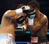 (1.27.2006 - Desert Diamond Casino, Tucson, AZ)  Francisco Mora scores to the head of Kassim Ouma in the 2nd round of their NABO Jr. Middleweight Championship bout.