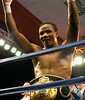 (1.27.2006 - Desert Diamond Casino, Tucson, AZ)  Ouma celebrating his 8th round knockout of Mora and regaining the Championship belt.