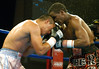 (1.27.2006 - Desert Diamond Casino, Tucson, AZ)  Mora and Ouma engaged in close quarter fighting in the 8th round of the NABO Jr. Middleweight bout.  Ouma would knock out Mora later in the 8th round to regain the championship belt.