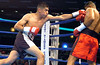 (1.27.2006 -- Desert Diamond Casino)  Praxedis Osuna (left) scores against Tomas Padron in the 1st round of their 4 round Jr. Middleweight bout.