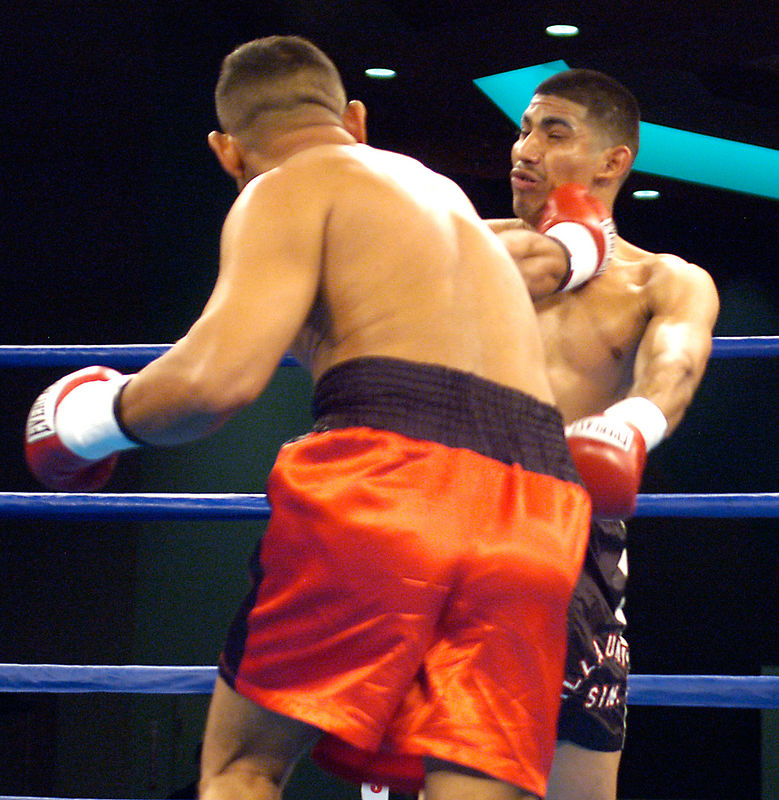 (1.27.2006 -- Desert Diamond Casino)  Tomas Padron lands a blow to the head of Praxedis Osuna in their 4 round Jr. Middleweight bout.  Padron and Osuna fought to a draw.