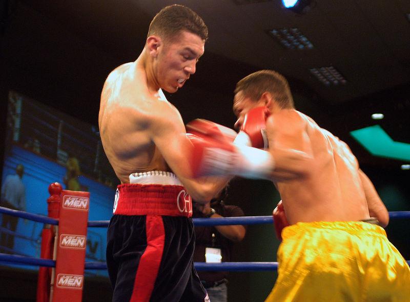 (1.27.2006 - Desert Diamond Casino, Tucson, AZ)  Vincente Escobedo fires an uppercut into the face of Jesus Salvador Perez in the 5th round of their 8 round Jr. Lighweight bout at the Desert Diamond Casino.