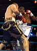 (1.27.2006 - Desert Diamond Casino, Tucson, AZ)  David Lopez scores to the midsection of Shay Mobley in the Middleweight bout.