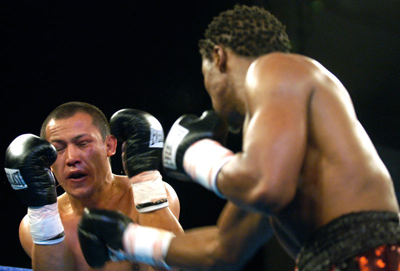 (1.27.2006 - Desert Diamond Casino, Tucson, AZ)  Francisco Mora reacts after getting stung by a right hand from Kassim Ouma in their 12 round NABO Championship bout.