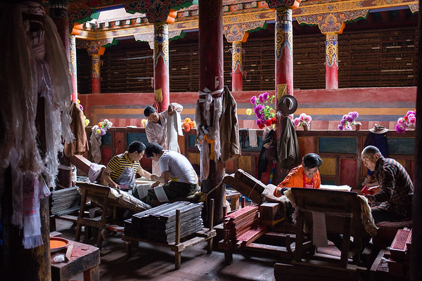 Artists prepare religious texts by hand in an artisinal printing press in the Tibetan town of Dege in Sichuan, China.